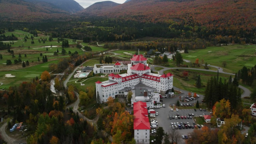 6K stock footage aerial video orbiting Omni Mount Washington Resort and Mount Washington Resort Golf Club, Carroll, New Hampshire Aerial Stock Footage | AX150_208