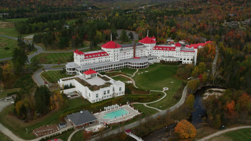 6K aerial video orbiting Omni Mount Washington Resort, autumn, Bretton Woods, Carroll, New Hampshire Aerial Stock Footage | AX150_210
