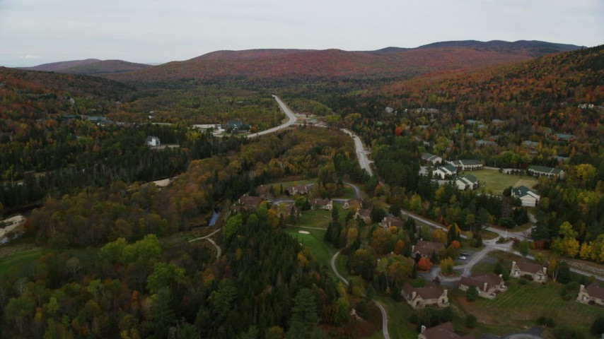 6K stock footage aerial video approaching Base Station Road, Highway 302, over rural homes, Carroll, New Hampshire Aerial Stock Footage | AX150_211