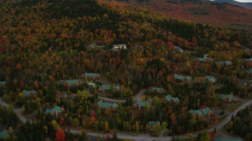6K stock footage aerial video flying by rural homes, colorful trees, autumn, Bretton Woods, Carroll, New Hampshire Aerial Stock Footage | AX150_212