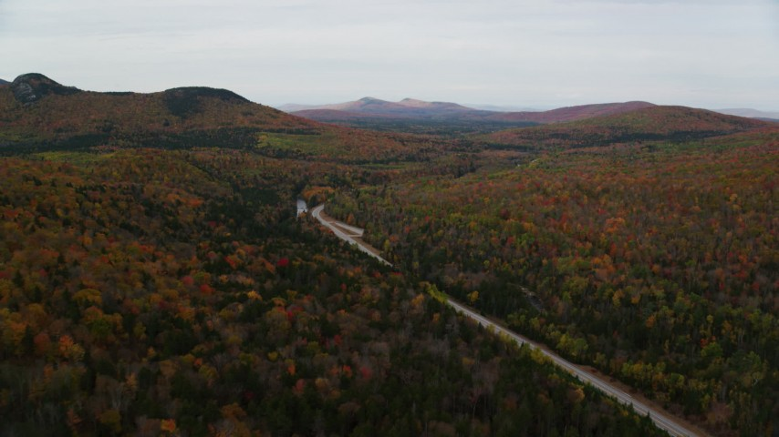 6K stock footage aerial video approaching, flying over Highway 302, forest, autumn, overcast, Carroll, New Hampshire Aerial Stock Footage | AX150_214
