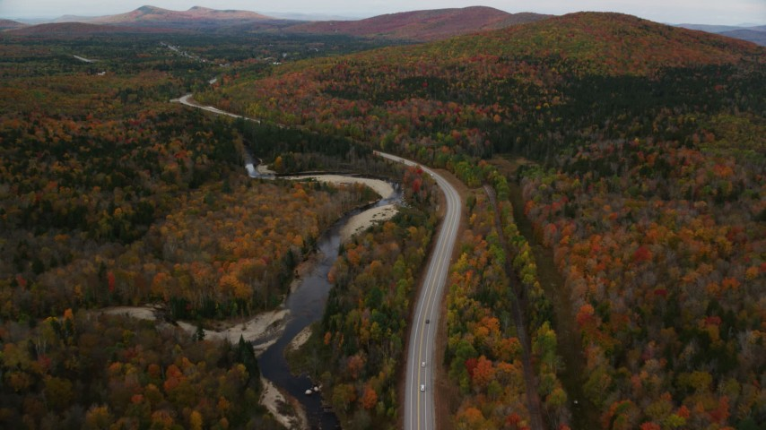 6K stock footage aerial video flying over Highway 302 through forest, autumn, overcast, Carroll, New Hampshire Aerial Stock Footage | AX150_216