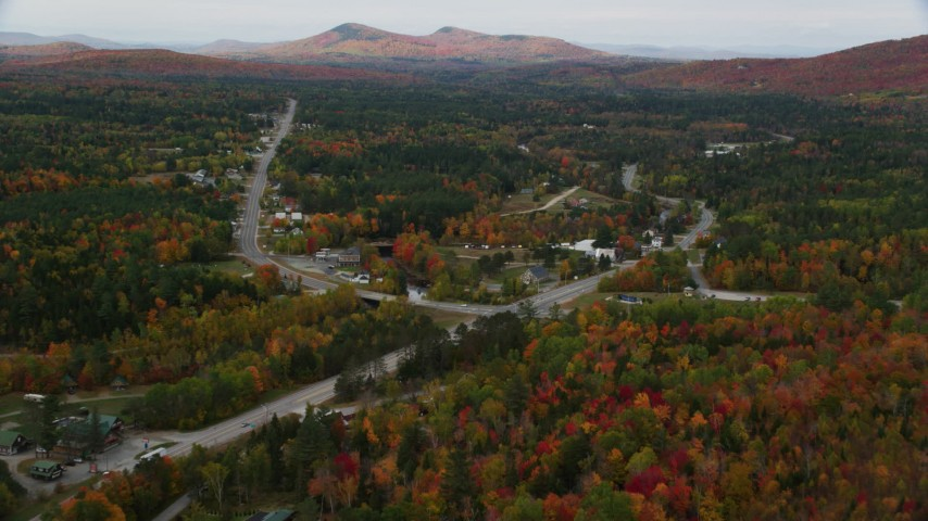 6K stock footage aerial video flying over Highway 302, approach small rural town, autumn, Carroll, New Hampshire Aerial Stock Footage | AX150_218