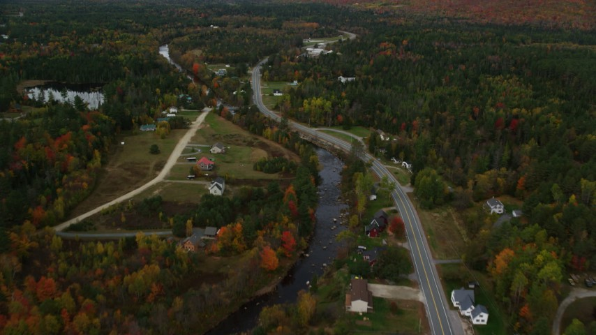 6K stock footage aerial video of Highway 302 through small rural town, Ammonoosuc River, autumn, Carroll, New Hampshire Aerial Stock Footage | AX150_219
