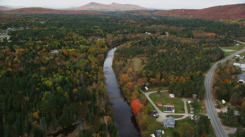 6K stock footage aerial video flying over small rural town, Ammonoosuc River, autumn, Carroll, New Hampshire Aerial Stock Footage | AX150_220