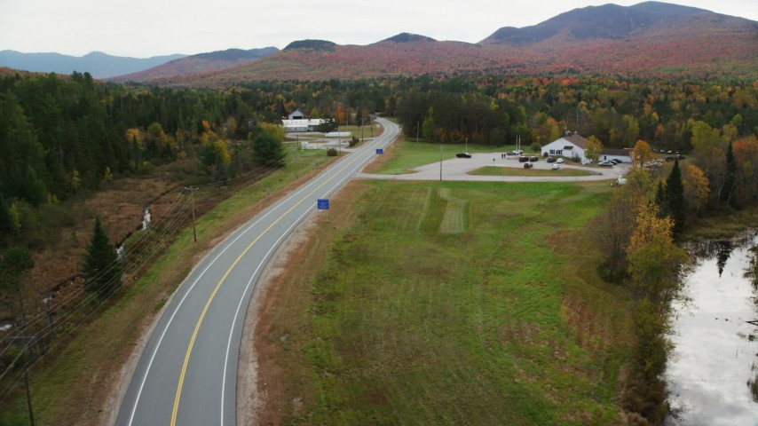 6K stock footage aerial video approaching North Hampshire Department of Safety, autumn, Carroll, New Hampshire Aerial Stock Footage | AX150_223