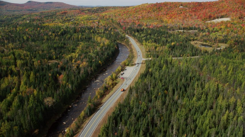 6K stock footage aerial video of Highway 302 along Ammonoosuc River, forests in autumn, Carroll, New Hampshire Aerial Stock Footage | AX150_226