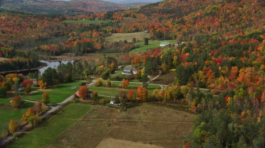 6K stock footage aerial video approaching a rural home, colorful foliage in autumn, Sugar Hill, New Hampshire Aerial Stock Footage | AX150_243