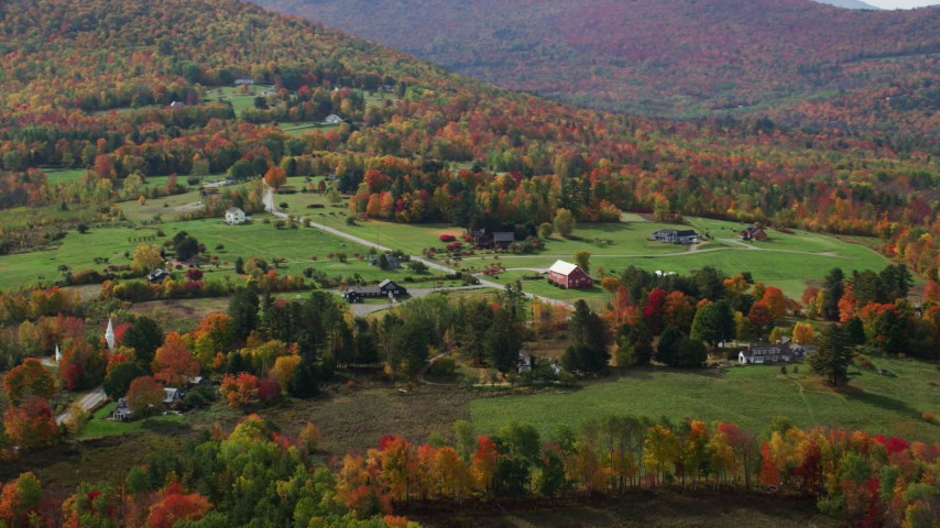 6K stock footage aerial video flying by rural homes, colorful trees in autumn, Sugar Hill, New Hampshire Aerial Stock Footage | AX150_244