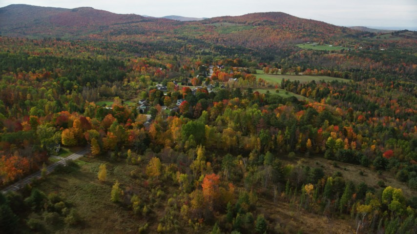 6K stock footage aerial video approaching small rural town, colorful foliage, autumn, Sugar Hill, New Hampshire Aerial Stock Footage | AX150_246