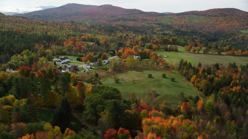 6K stock footage aerial video flying by colorful trees, rural homes, small rural town, autumn, Sugar Hill, New Hampshire Aerial Stock Footage | AX150_247