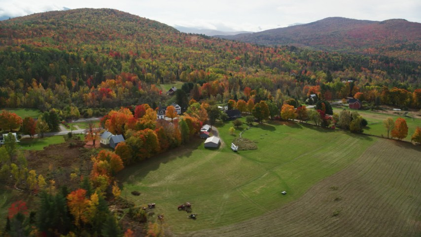 6K stock footage aerial video orbiting a small rural town, colorful trees in autumn, Sugar Hill, New Hampshire Aerial Stock Footage | AX150_248