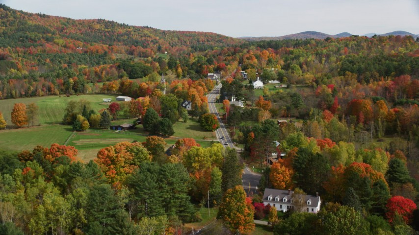 6K stock footage aerial video flying over small rural town, approach Sugar Hill Road, autumn, Sugar Hill, New Hampshire Aerial Stock Footage | AX150_251