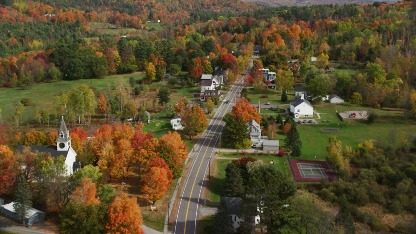 6K stock footage aerial video flying over Sugar Hill Road through small rural town, autumn, Sugar Hill, New Hampshire Aerial Stock Footage | AX150_252