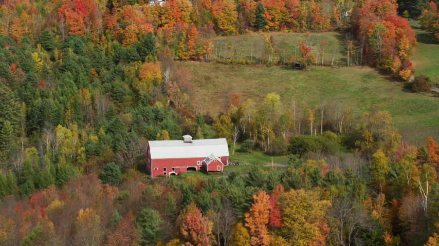 6K stock footage aerial video flying by a red barn, colorful foliage, autumn, Sugar Hill, New Hampshire Aerial Stock Footage | AX150_254