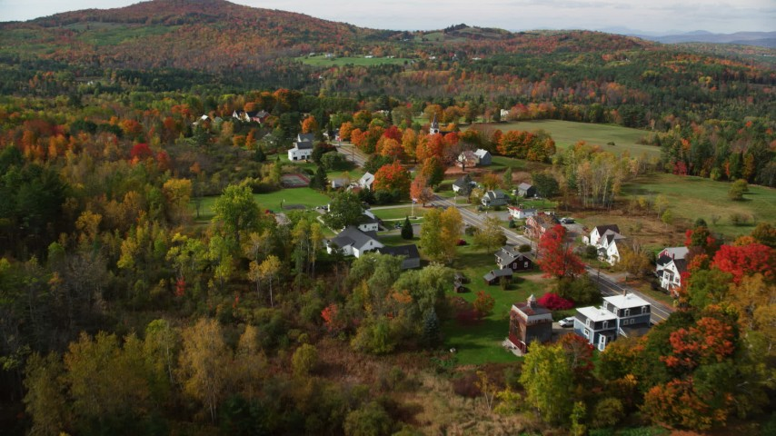 6K stock footage aerial video flying over small rural town, by a church, autumn, Sugar Hill, New Hampshire Aerial Stock Footage | AX150_256