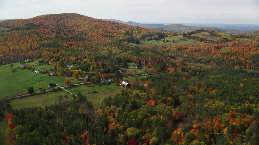 6K stock footage aerial video approaching Pearl Lake Road, tilt down over rural homes, pond, autumn, Lisbon, New Hampshire Aerial Stock Footage | AX150_257