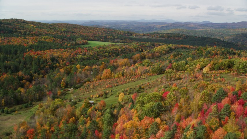 6K stock footage aerial video flying over forest of brightly colored trees, autumn, Lisbon, New Hampshire Aerial Stock Footage | AX150_262