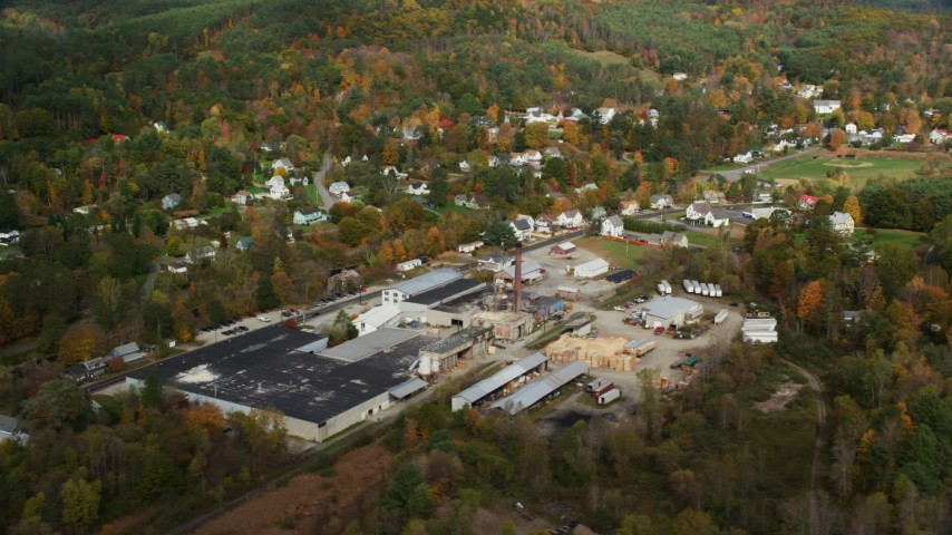 6K stock footage aerial video flying by a factory near river, small town, autumn, Lisbon, New Hampshire Aerial Stock Footage | AX150_265