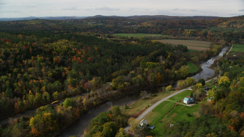 6K stock footage aerial video flying over rural homes, Ammonoosuc River, approach farm, autumn, Lisbon, New Hampshire Aerial Stock Footage | AX150_267