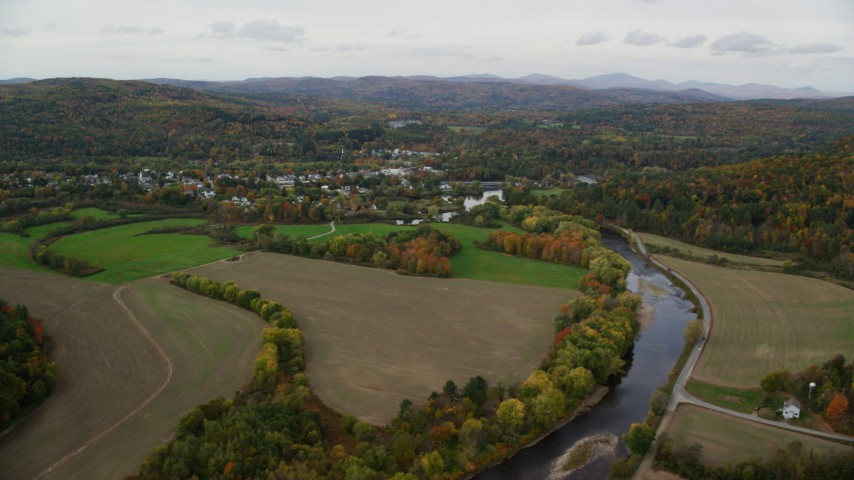 6K stock footage aerial video flying over small farms Ammonoosuc River, approach rural town, autumn, Woodsville, New Hampshire Aerial Stock Footage | AX150_283