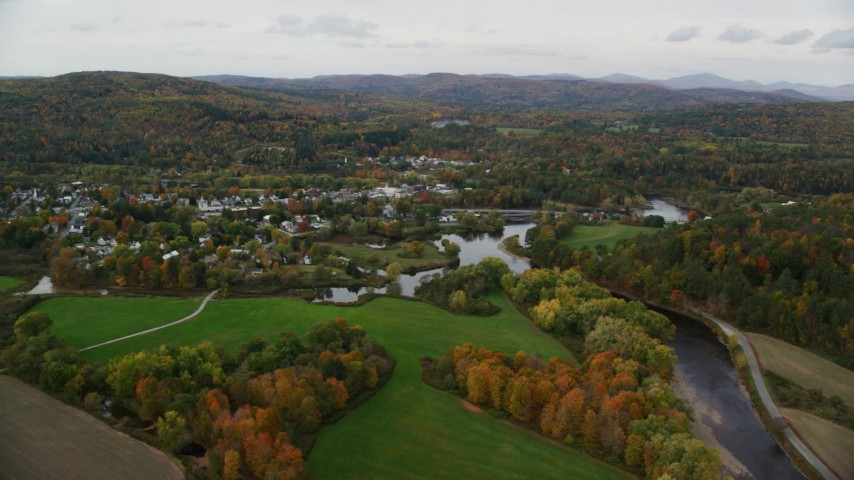 6K stock footage aerial video flying over Ammonoosuc River, approach small rural town, autumn, Woodsville, New Hampshire Aerial Stock Footage | AX150_284