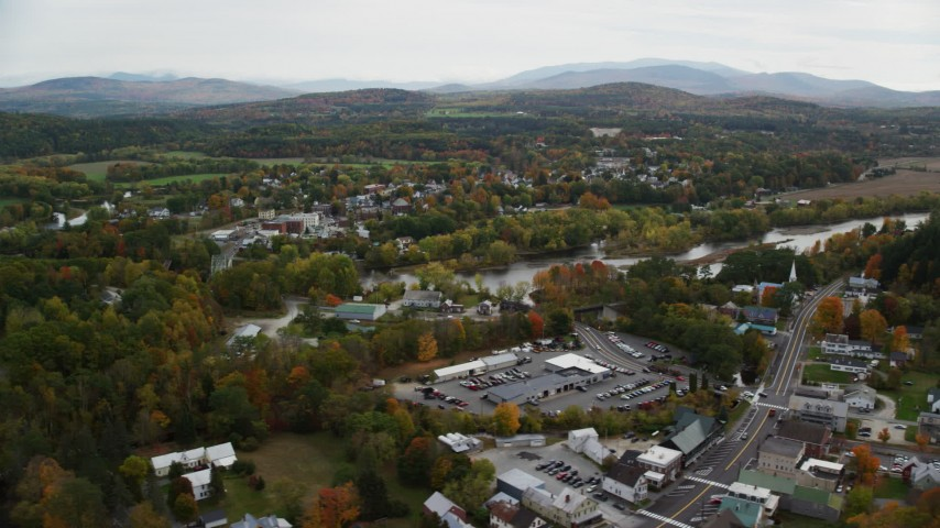 6K stock footage aerial video orbiting small rural town, autumn, Woodsville, New Hampshire and Wells River, Vermont Aerial Stock Footage | AX150_288