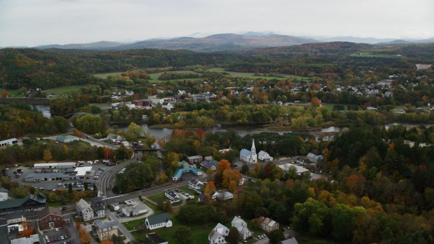 6K stock footage aerial video flying by small rural town, colorful foliage, autumn, Woodsville, New Hampshire and Wells River, Vermont Aerial Stock Footage | AX150_289