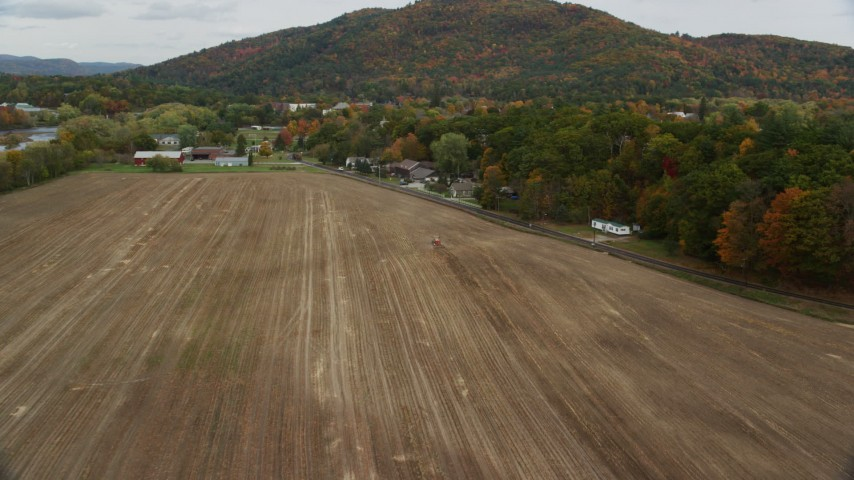 6K stock footage aerial video approaching tractor, farmland, Hospital Road, autumn, Woodsville, New Hampshire Aerial Stock Footage | AX150_292