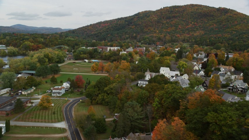 6K stock footage aerial video flying over Hospital Road, small rural town, autumn, Woodsville, New Hampshire Aerial Stock Footage | AX150_293