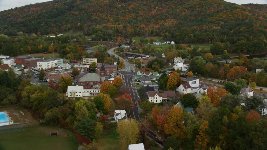 6K stock footage aerial video flying over small town, approach Bath-Haverhill Bridge, autumn, Woodsville, New Hampshire Aerial Stock Footage | AX150_294
