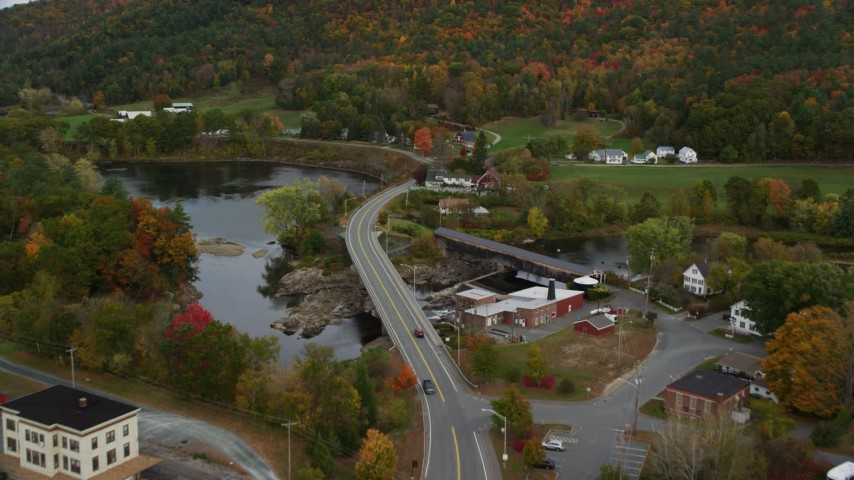 6K stock footage aerial video approaching small town, Bath-Haverhill Bridge, Ammonoosuc River, autumn, Woodsville, New Hampshire Aerial Stock Footage | AX150_295