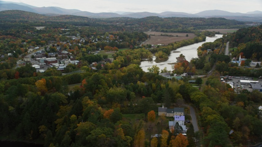 6K stock footage aerial video orbiting small rural towns, Connecticut River, autumn, Woodsville, New Hampshire and Wells River, Vermont Aerial Stock Footage | AX150_297