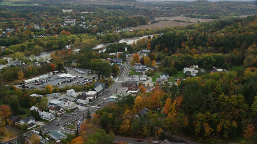 6K stock footage aerial video orbiting small rural towns, Connecticut River, autumn, overcast, Wells River, Vermont Aerial Stock Footage | AX150_298