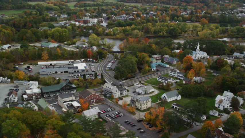 6K stock footage aerial video of small rural towns, car dealership near Connecticut River, autumn, Wells River, Vermont Aerial Stock Footage | AX150_299