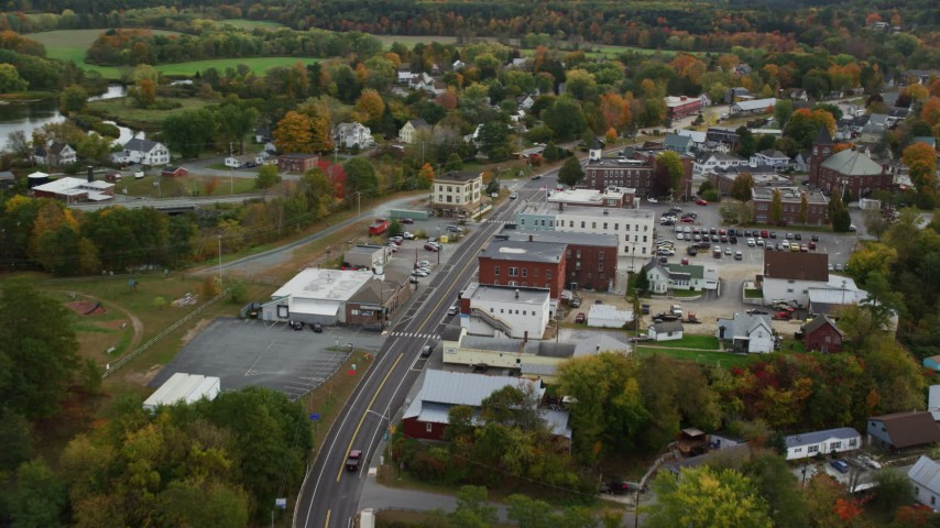 6K stock footage aerial video flying over Central Street through small town, Connecticut River, autumn, Woodsville, New Hampshire Aerial Stock Footage | AX150_301