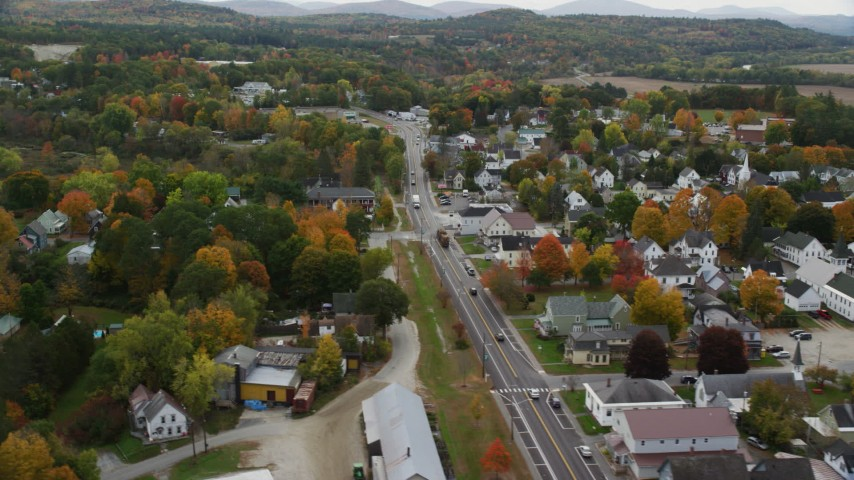 6K stock footage aerial video flying over Central Street, by a small rural town, autumn, Woodsville, New Hampshire Aerial Stock Footage | AX150_302