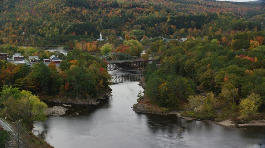 6K stock footage aerial video of a small rural town, bridges, Connecticut River, autumn, Woodsville, New Hampshire and Wells River, Vermont Aerial Stock Footage | AX150_303