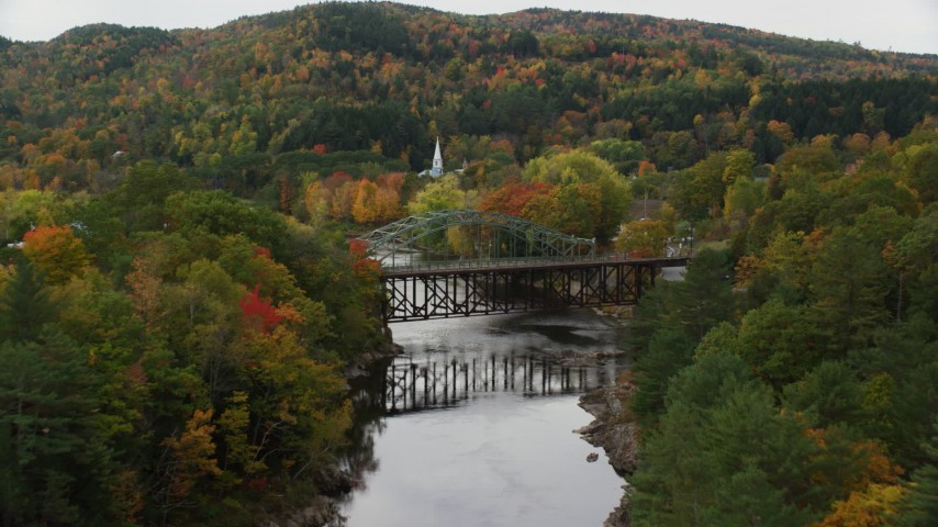 6K stock footage aerial video flying over bridges, Connecticut River, approach small town, autumn, Wells River, Vermont Aerial Stock Footage | AX150_304