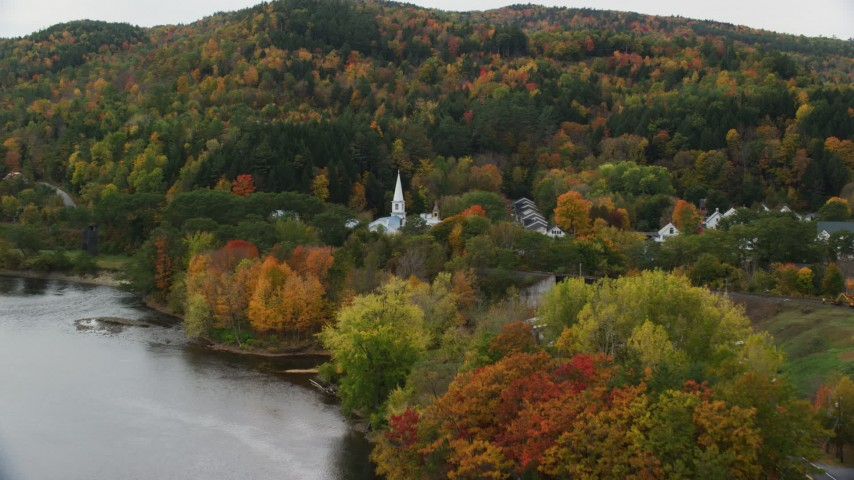 6K stock footage aerial video approaching and flying by a church in a small town in autumn, Wells River, Vermont Aerial Stock Footage | AX150_305