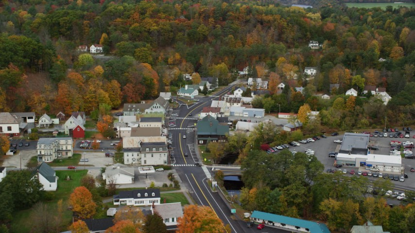 6K stock footage aerial video flying by small rural town, tilting up Main Street, autumn, Wells River, Vermont Aerial Stock Footage | AX150_306