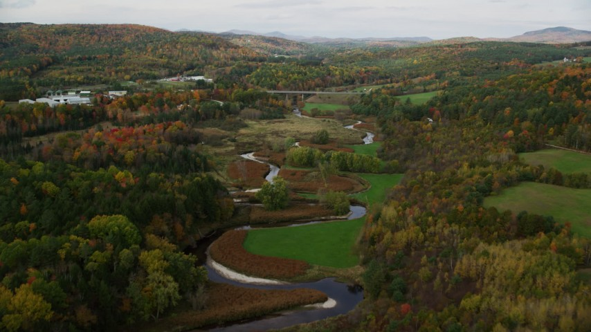 6K stock footage aerial video flying over small river, approaching a small river in autumn, Wells River, Vermont Aerial Stock Footage | AX150_308