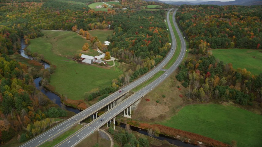 6K stock footage aerial video approaching a small bridge, Interstate 91 across a small river, autumn, Wells River, Vermont Aerial Stock Footage | AX150_309