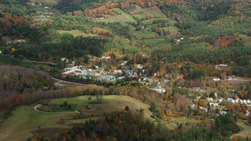 6K stock footage aerial video flying by small rural town, grassy clearings, foliage in autumn, Ryegate, Vermont Aerial Stock Footage | AX150_314
