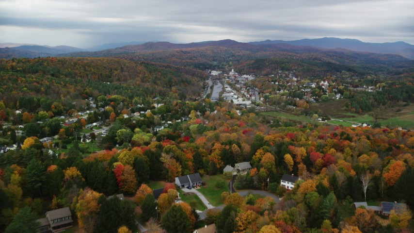6K stock footage aerial video approaching and flying over homes, colorful trees in autumn, overcast, Montpelier, Vermont Aerial Stock Footage | AX150_351