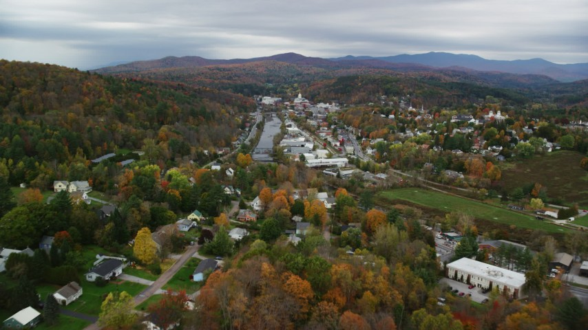 6K stock footage aerial video flying over homes, approach small bridge, Winooski River, autumn, Montpelier, Vermont Aerial Stock Footage | AX150_352