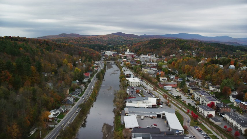 6K stock footage aerial video flying over Winooski River, approach downtown, autumn, Montpelier, Vermont Aerial Stock Footage | AX150_353