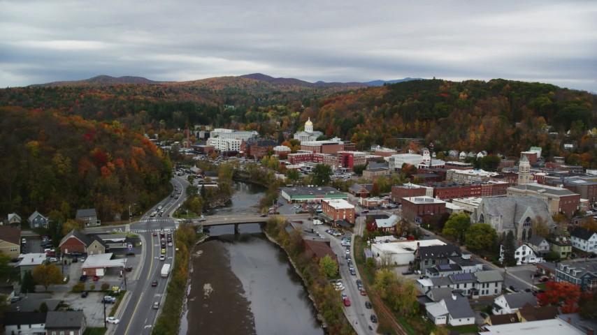 6K stock footage aerial video flying over Winooski River, approach downtown, Vermont State House, autumn, Montpelier, Vermont Aerial Stock Footage | AX150_354