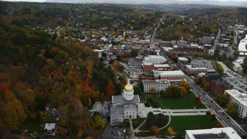 6K stock footage aerial video orbiting Vermont State House in autumn, downtown, Montpelier, Vermont Aerial Stock Footage | AX150_356
