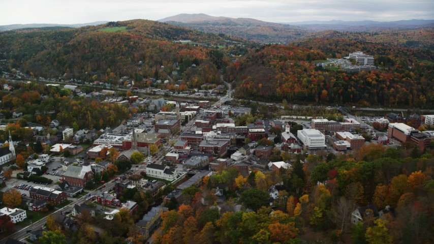 6K stock footage aerial video flying by buildings in downtown, autumn trees, Montpelier, Vermont Aerial Stock Footage | AX150_358